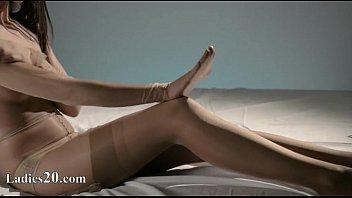 Luxury babe in nylon jerking off strapon